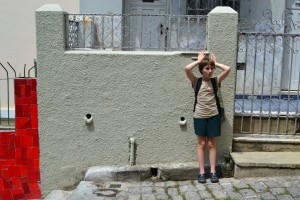 Sophia imitating the face on the wall behind her. She worries us sometimes.