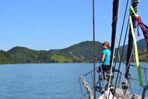 """Franci in the """"pulpit"""" while we motor down fjord Mamangua"""