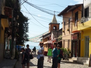 Walking through Abraõ. The town is getting ready for a religious festival on the morrow.