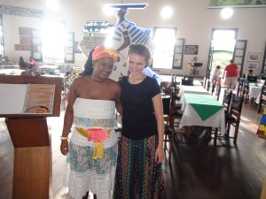 One of the waitresses in traditional costume standing here with Marike.