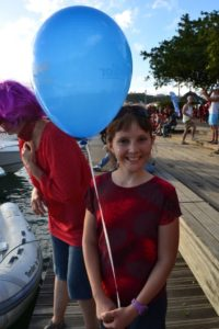 In the background mom is wearing a nice purple wig and Sophia is very happy with her helium baloon