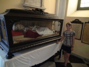 """One of the Old Churches in Old San Juan has this lifesize """"Doll"""" in a glass case. We were told it was a relic of a real saint, but only on closer inspection could we see the skeleton hidden inside. The part that is visible are the brown teeth as the mouth of the cast is slightly open."""