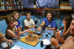 Sophia, Franci, Yuca, Karin J, Maria and Frans. They are enjoying the Dessert Pizza that Marike topped with Caramel and Peppermint Crisp Chocolate.