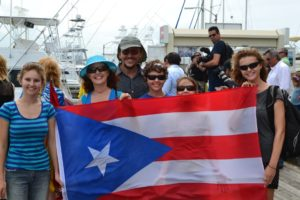Our whole family behind the huge Puerto Rico flag that was used to welcome a Spanish Nobleman after he travelled very far and wide on a Jetski. He is travelling around the World duplicating old trade routes and raising money (I think).