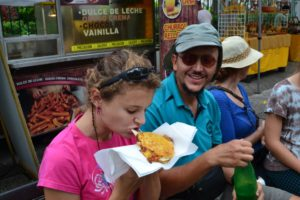"""You've caught Marike in the act of eating a ham and cheese """"pie"""". This was bought from a little stall on a festive pavement on the way back from Old San Juan."""