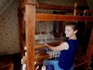 Me siting at an identical loom in the last house we visited.